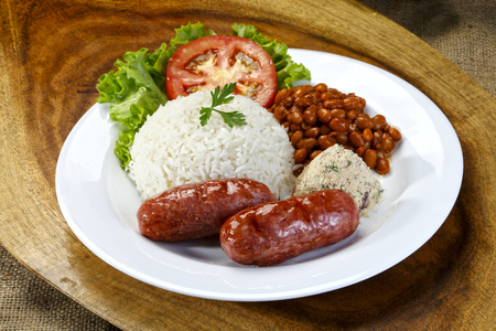 Sausage with rice and salad