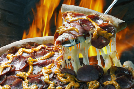 Slice of pizza raised