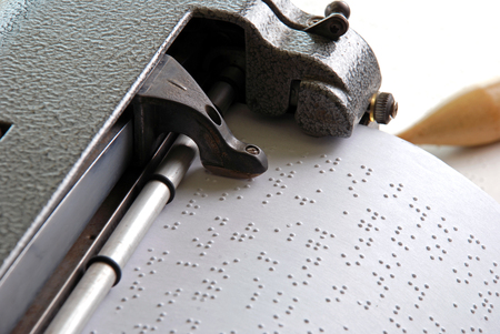 Braille machine writing Stock Photo