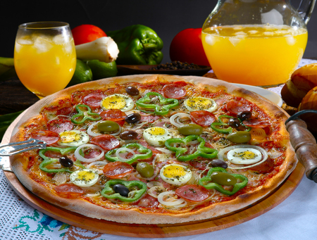 Portuguese Pizza, onion, peppers, pepperoni, egg, olive Stock fotó