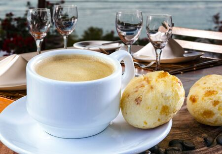 Brazilian snack cheese bread, pao de queijo, Brazilian snack cheese bread and a cup of coffee
