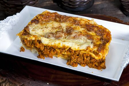 Traditional lasagna made with minced beef bolognese sauce