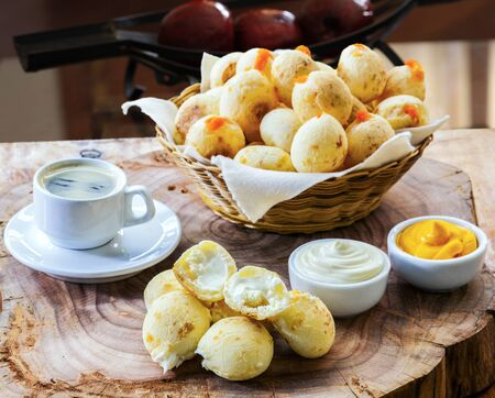 Breakfast with stuffed cheese bread, pao de queijo Foto de archivo - 150528987