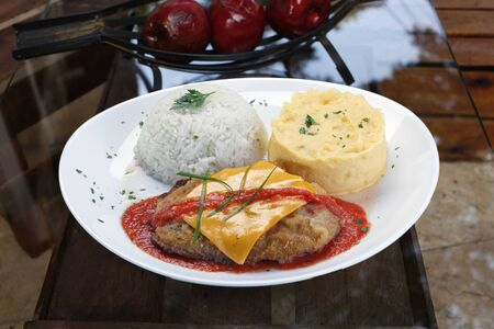 parmigiana steak with mashed potatoes and white rice