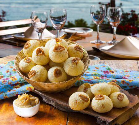 Breakfast with stuffed cheese bread with dulce de leche, pao de queijo