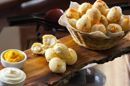 Breakfast with stuffed cheese bread, pao de queijo Foto de archivo