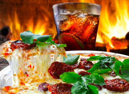 Pizza slice melted cheese with cold cola soda