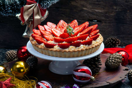 Strawberry tart with white cream and christmas decoration