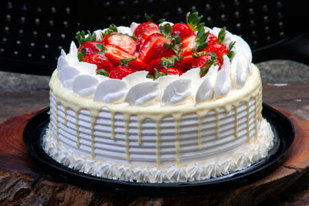 White chocolate, strawberry and whipped cream cake