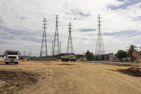 eletrical: Rio de Janeiro, Brazil: View of infrastructure works in the suburbs of Rio de Janeiro. View of electricity pylons of high voltage being installed. Works of electrical engineering. Photo taken on July 1, 2015.