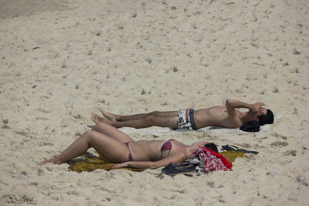 bathers: Rio de Janeiro, Brazil, 1 April 2016: Bathers enjoy the beaches of Rio de Janeiro during the fall. The temperature in the city is in the range of 30 degrees Celsius. Tourists and locals enjoying the Ipanema Beach and Arpoador, the south of the city. Editorial