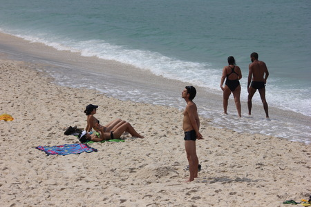 sun bathers: Rio de Janeiro, Brazil, 1 April 2016: Bathers enjoy the beaches of Rio de Janeiro during the fall. The temperature in the city is in the range of 30 degrees Celsius. Tourists and locals enjoying the Ipanema Beach and Arpoador, the south of the city. Editorial