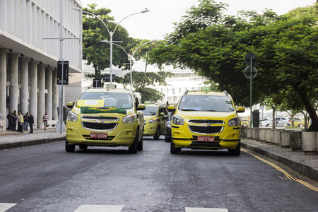 authorizing: Rio de Janeiro, 1 April 2016: Hundreds of taxis in Rio de Janeiro held a protest of major proportions that paralyzed traffic in the city throughout the day. The taxi drivers were protesting against a court decision authorizing the operation of Uber in the