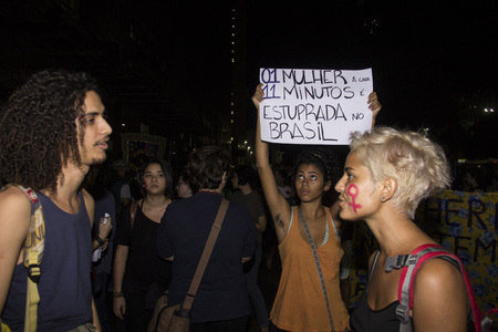 sexually: Rio de Janeiro, Brazil, 01 June 2016: Hundreds of women held a demonstration in Rios downtown streets to protest against sexism and against the gang rape suffered by a girl of 16 years old. The girl had been sexually abused by more than 30 men and police Editorial