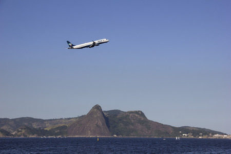 f 15: Rio de Janeiro, Brazil, 15 June 2016: View of airport runway Santos Dumont in Rios center. The airport is washed by the waters of Guanabara Bay, near where the Olympic competitions will be held sailing and during the airport competitions will be closed f Editorial