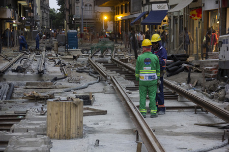 olympic games: Rio de Janeiro, Brazil, 20 June 2016: Workers continue working on Olympic construction in downtown Rio. There are only 46 days to the start of the Olympic Games Rio 2016 and there are still many works being completed throughout the city. In this image lab Editorial