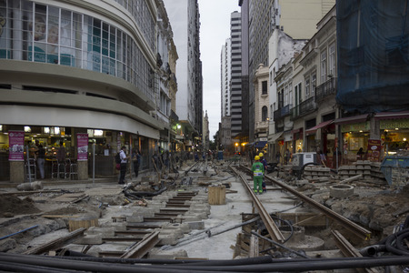 the olympic games: Rio de Janeiro, Brazil, 20 June 2016: Workers continue working on Olympic construction in downtown Rio. There are only 46 days to the start of the Olympic Games Rio 2016 and there are still many works being completed throughout the city. In this image lab Editorial