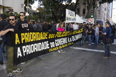 affects: Rio de Janeiro, Brazil, 27 June 2016: Civil Police of Rio de Janeiro make shutdown for a few hours and act of protest against the economic crisis that affects the work of the police. In some police stations there is no paper for the hit record and there a