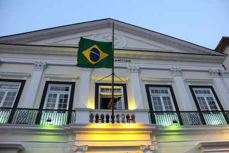 pyre: Rio de Janeiro, Brazil, September 18, 2016: Brazil flag is removed from the building of the Navy of Brazil, in the Rio 2016 Olympic Boulevard.