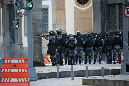 Rio de Janeiro, Brazil, December 6, 2016: Tension in Rio de Janeiro downtown. Demonstrators and police officers clashed and there was police truculence to disperse the demonstrators.