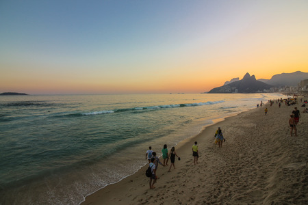 Rio de Janeiro, Brazil, July 23, 2017: Although officially Rio de Janeiro is in winter, the heat allows Rio locals and tourists to enjoy the beaches of the city. Temperatures in the city remain above 25 degrees Celsius for much of the winter. In this imag Editorial