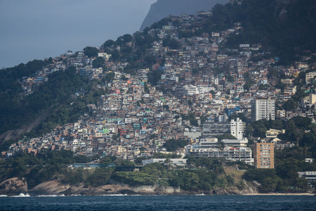 View of Vidigal Favela in Rio de Janeiro, located between Leblon and São Conrado, two of Rio de Janeiros noblest neighborhoods. The Vidigal favela was built on Two Brothers Hill and despite being a poor region, it is a popular tourist spot in Rio de Jan