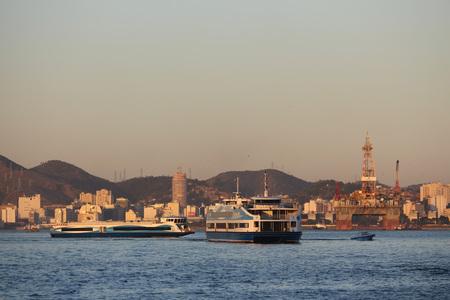Rio de Janeiro, Brazil, August 7, 2017: Rio de Janeiro has sunny and hot afternoon in winter. boats that make the crossing between Rio de Janeiro and Niteroi. Editorial