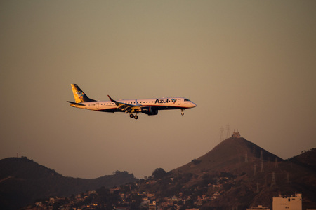 Rio de Janeiro, Brazil, August 7, 2017:  Azuls plane overfly waters from Guanabara Bay to land at Santos Dumont Airport, Downtown Rio.