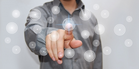 Hand reaching out to touch button Stock Photo
