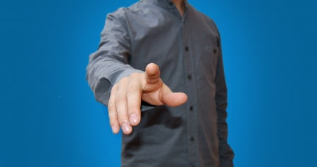 Businessman pressing an imaginary button Stock Photo