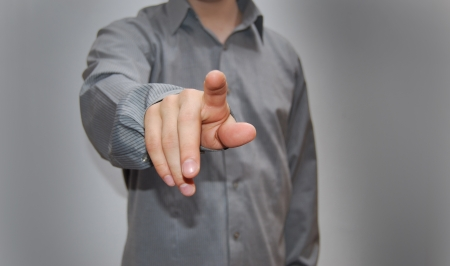 Businessman pressing an imaginary button Stock Photo