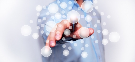 Businessman pressing virtual media type of buttons  Stock Photo
