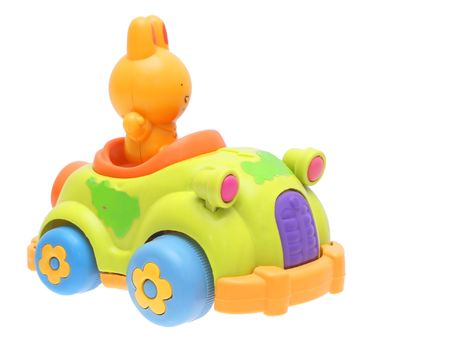 Toys, rabbit in the car on a white background.