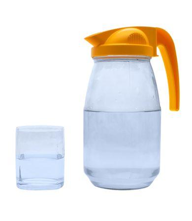 Jug, glass with water on a white background.                     Reklamní fotografie