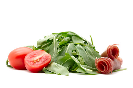parma ham: Concept of italian and mediterranean food. Fresh, green,rocket leaves, red cherry tomato, sliced cherry tomato and rolled parma ham. Pure white background.