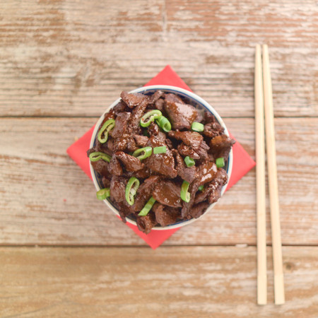 Concept of Chinese food. Beef cooked in soy sauce with spring onions and star anise served in a china bowl. Stock Photo