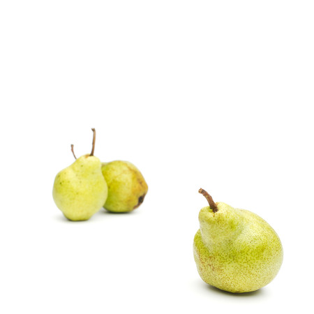 williams: Three Williams sort pears isolated against white background selective focus on front pear. Square crop. Copy space.