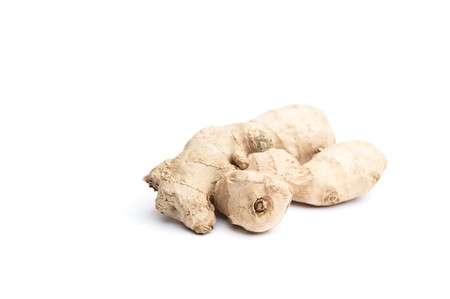 ginger root: Uncut spice ginger root isolated against white background selective focus