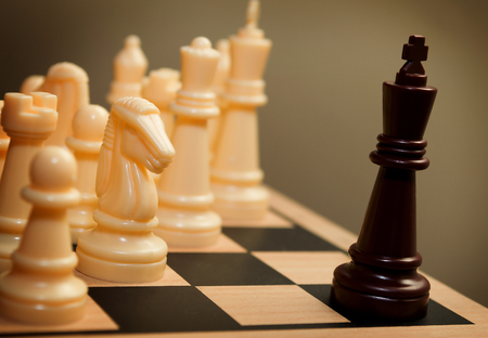 subjugation: Chess king surrendering Stock Photo