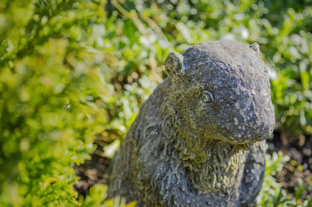 statuary garden: Stone beaver among garden plants
