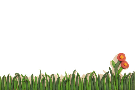 child's play clay: green grass with flower on a white background (clay)