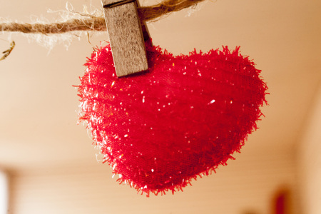 fetishes: red heart which hangs on a rope hairy Stock Photo