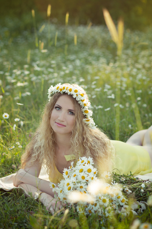 daisie: Beautiful lady with cute daughter on camomile field full of flowers
