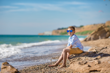 fashion boy on the beach with sun glasses