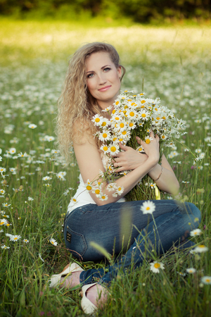 daisie: Beautiful lady on camomile field full of flowers