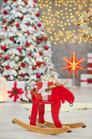 Christmas studio decorations wonderful idea mainly white and red New Year tree with snow and plenty presents under Amazing LED lights bake and huge paper