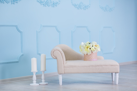 Studio interier decoration with flowers in light warm colors and casual vintage furniture. Banco de Imagens