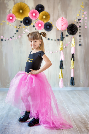Cute beautifull girl lady posing in fancy violet dress skirt with number seven celebrating her birthday day with fun and joyful in studio scene .