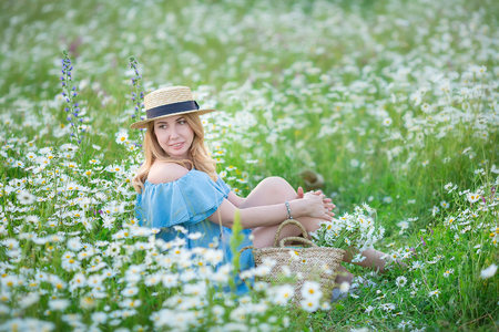 Outstanding beautiful girl lady on the daisy flowers field enjoying summer spring time with full soul of vacation.
