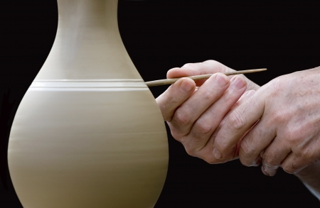 craftsmanship: Close-up view of potter s hands at work